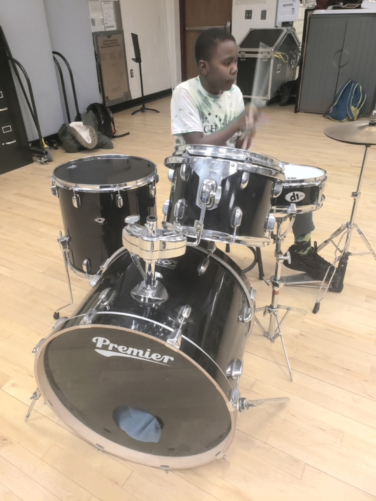 6th grade student, Kameer is hard at work on the drums in the after school program.